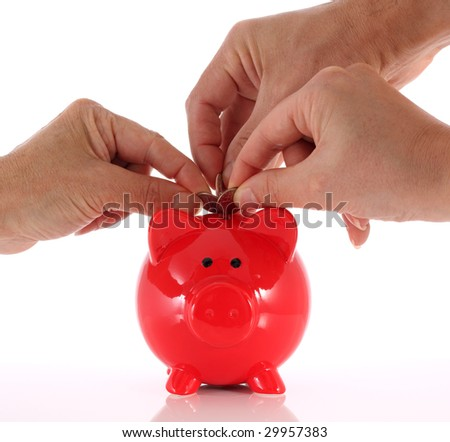 People rushing to put money in a piggy bank - stock photo
