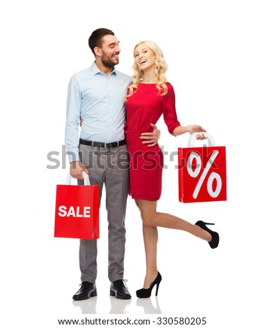 people, sale, discount and holidays concept - happy couple hugging with red shopping bags - stock photo