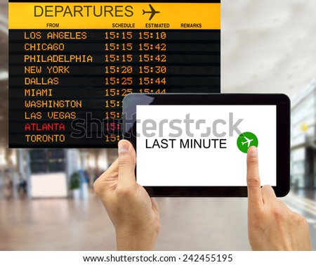 people search for last minute deals at an usa airport with your tablet - stock photo