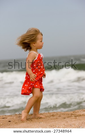 people series: little girl are run on the beach