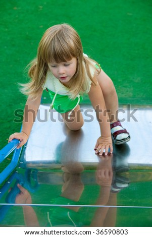 people series: little girl play on the chute