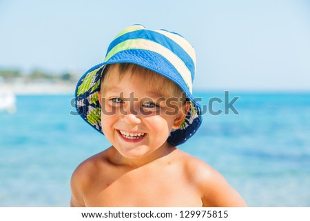 People series: portarit of boy on summer sea beach - stock photo