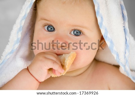 people series: portrait of adorable baby with bread - stock photo
