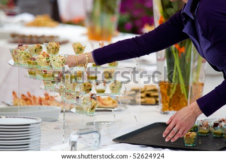 People serving during a weeding buffet - stock photo