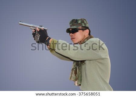 people shooting guns - stock photo
