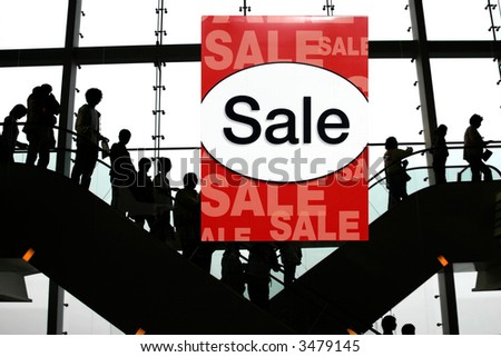 People shopping at the mall - stock photo