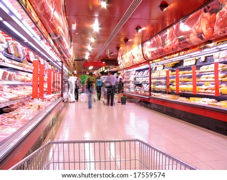 People shopping at the supermarket - stock photo