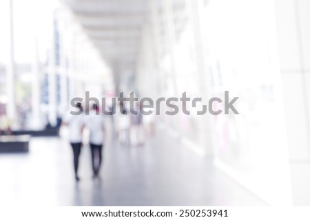 People shopping in department store. Blurred background.  - stock photo
