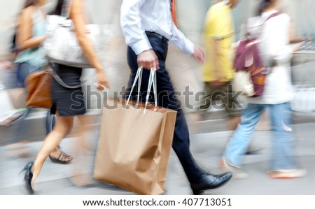people shopping in the city in motion blur - stock photo