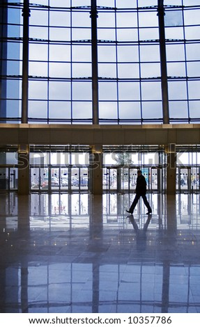 People silhouettes at office building - stock photo
