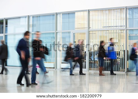 people silhouettes in motion blur - stock photo