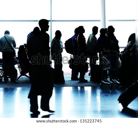 People silhouettes traveling on airport - stock photo