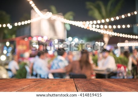People sit in a blur banquets. - stock photo