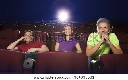 People sitting in movie theater, watching movie - stock photo
