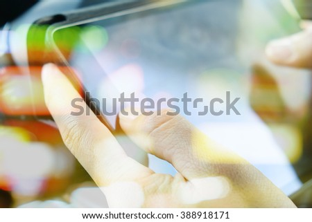 people sitting in the car using digital tablet, communication technology  - stock photo