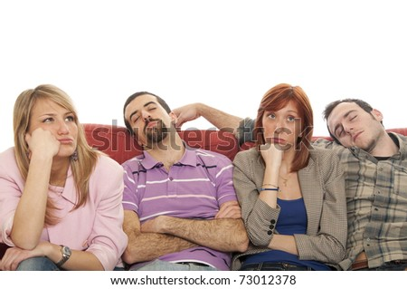People sitting on a sofa - stock photo