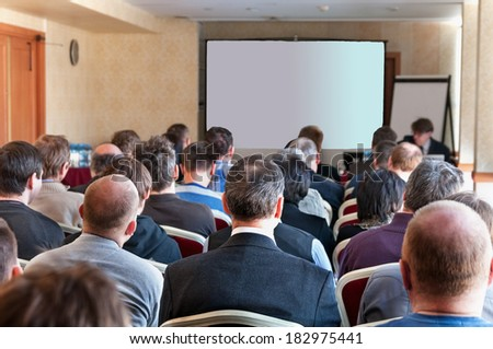 people sitting rear at the business conference. - stock photo