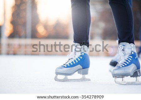 people skating on the ice city rink  - stock photo