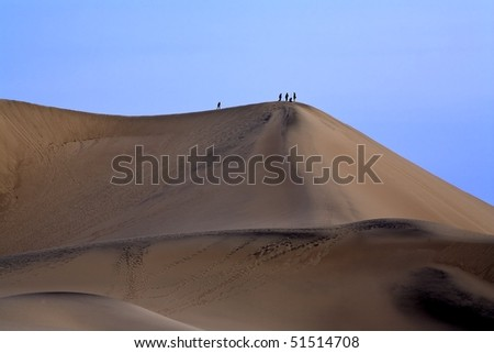 People standing on a sand dune at Death Valley National Park California.