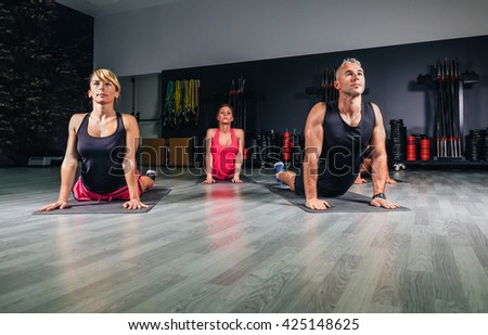 People stretching back in a fitness class - stock photo