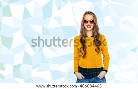 people, style and fashion concept - happy young woman or teen girl in casual clothes and sunglasses over low poly blue background - stock photo