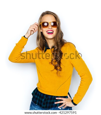 people, style and fashion concept - happy young woman or teen girl in casual clothes and sunglasses - stock photo