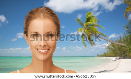 people, suntan, travel and summer holidays concept - close up of beautiful smiling woman with half face tanned over exotic tropical beach with palm trees background - stock photo