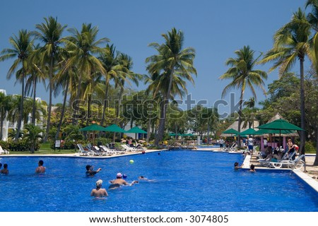 People swimming inthe gorgeous pool at a tropical resort in El Salvador - stock photo