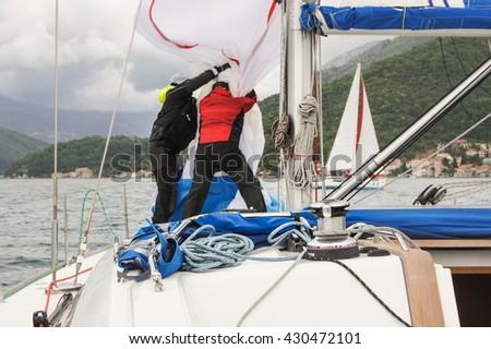 "People take in sail yacht. Tivat, Montenegro - 26 April, 2016. Regatta ""Russian stream"" in God-Katorskaya bay of the Adriatic Sea off the coast of Montenegro. - stock photo"