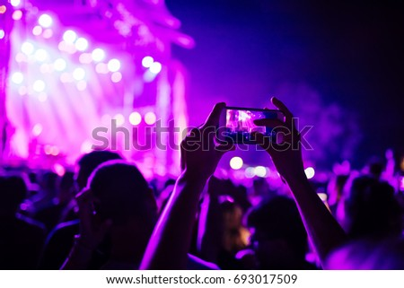 People Taking Photos At A Music Concert With Smartphones