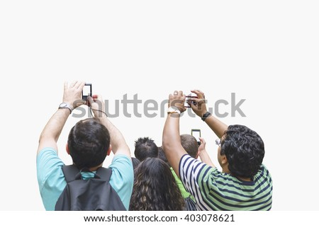 People taking pictures with cameras and mobile phones. Crowd of people taking photographs. Shoot picture - stock photo