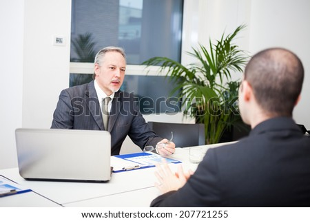 People talking about business in their office - stock photo