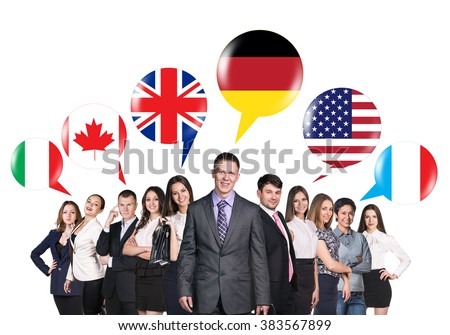 People talking with foreign speech bubbles - stock photo