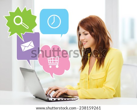 people, technology and internet concept - smiling woman sitting on couch with laptop computer at home with internet icons - stock photo