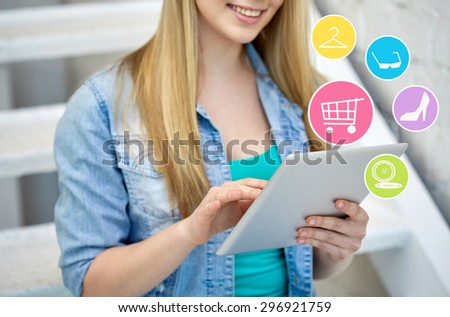 people, technology and online shopping concept - close up of female with tablet pc computer and internet icons on stairs - stock photo