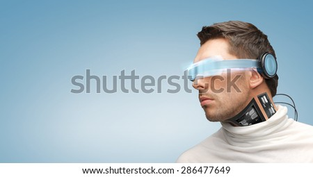 people, technology, future and progress - man with futuristic glasses and microchip implant or sensors over blue background - stock photo