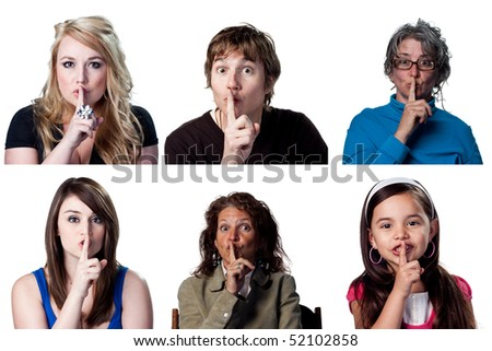 people telling others to be silent, fingers on lips - stock photo