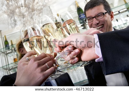 People toasting their glasses of champagne on New Years Eve - stock photo