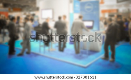 People, trade show background. Intentionally blurred post production.