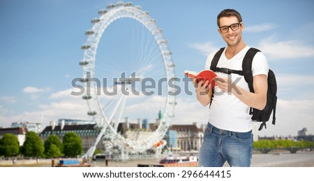 people, travel, tourism and education concept - happy young man with backpack and book over london ferry wheel background - stock photo