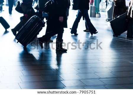 people traveling at the airport ( motion blur) - stock photo