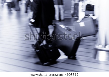 people traveling at the airport ( Used a long exposure for motion blur)