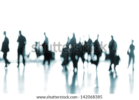 People traveling on airport silhouettes - stock photo