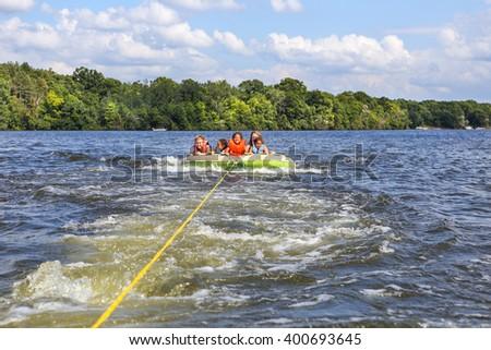 People tubing on an inland lake - stock photo