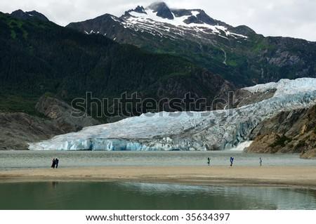 People viewing Mendenhall Glacier and Waterfall, Juneau, Alaska - stock photo