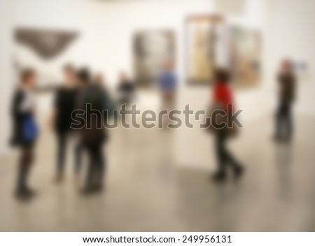 People visit art gallery, background. Intentionally blurred editing post production background. - stock photo