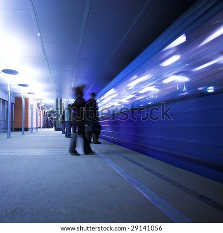 People wait train on underground station - stock photo