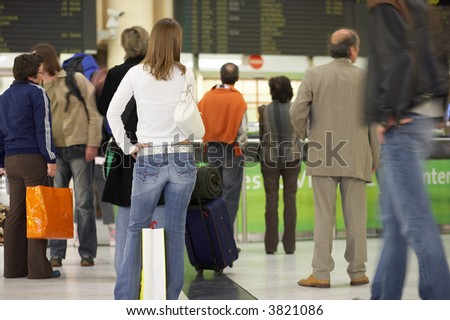 people waiting at the airport - stock photo