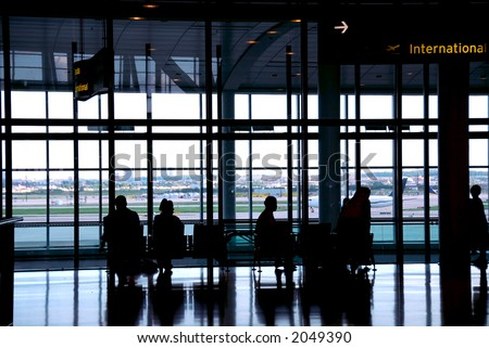 People waiting at the international airport terminal - stock photo