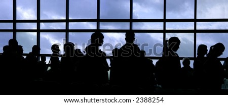 People waiting in line at the airport silhouette